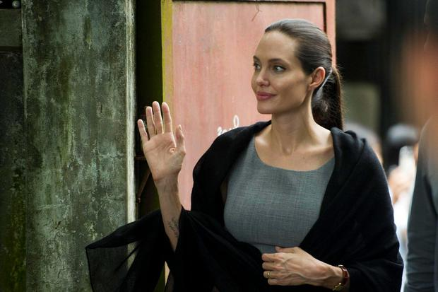 UN High Commissioner for Refugees (UNHCR) Goodwill Ambassador Angelina Jolie leaves after meeting with women factory workers at a hostel in Hlaing Thar Yar Township in Yangon on August 1, 2015