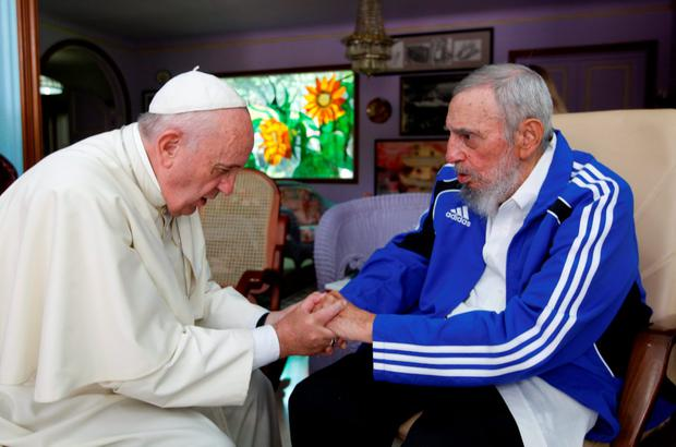 Pope Francis holds hands with Fidel Castro in Havana in Cuba Credit: Alex Castro (AP)
