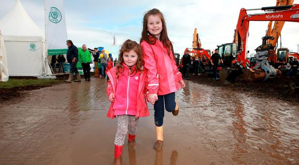 Sisters Amy [4] and Emma [7] O Brien from Ballyduff Upper, pictured at the National Ploughing Championships in Rathaniska Co Laois.Picture Credit Frank Mc Grath. 22/9/15