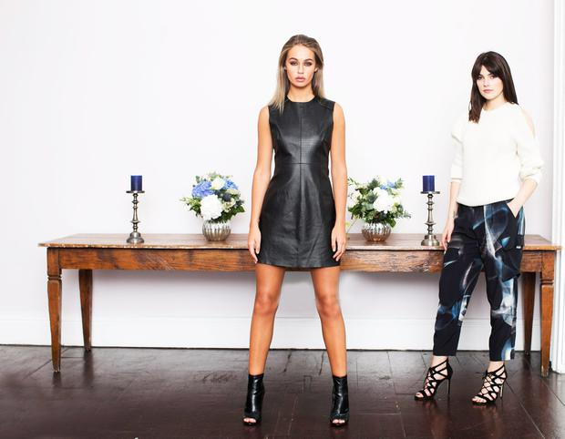 Thalia wears a leather dress, €161 and Kelly wears a cream plait knit, €87 and smoke trousers, €87 by Zoe Jordan for River Island.