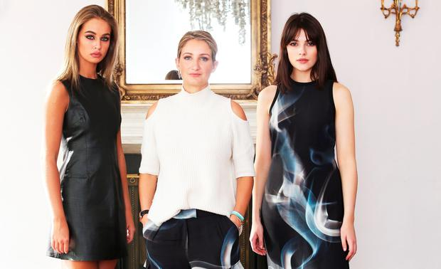 Designer Zoe Jordan with models Thalia (left) wearing a Leather dress, €161 and Kelly (right) wearing a cream plait knit, €87 and smoke trousers, €87.