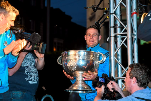 Dublin's Stephen Cluxton brings the Sam Maguire cup onto the stage during the team homecoming.