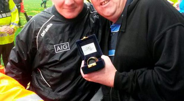 John Garbutt with his father's ashes at Hill 16 Croke Park with Dublin manager Jim Gavin