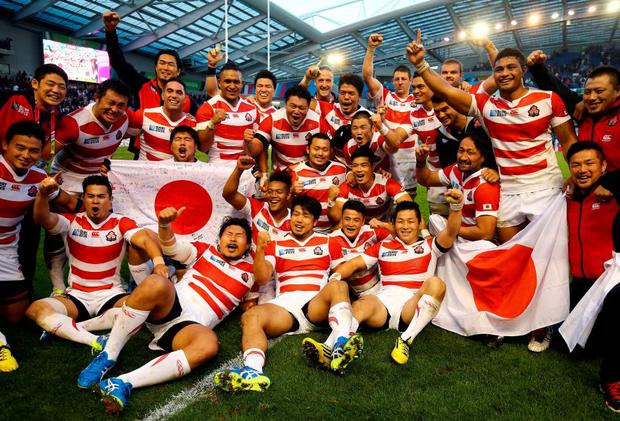 Japan celebrate victory over South Africa during the Rugby World Cup
