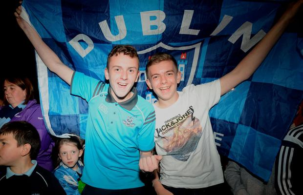 21/09/15. Josh Coleman (15) and James Tracey (13) from Coolock to watch the Dubs arriving at Parnell GAA club with the Sam Maguire
