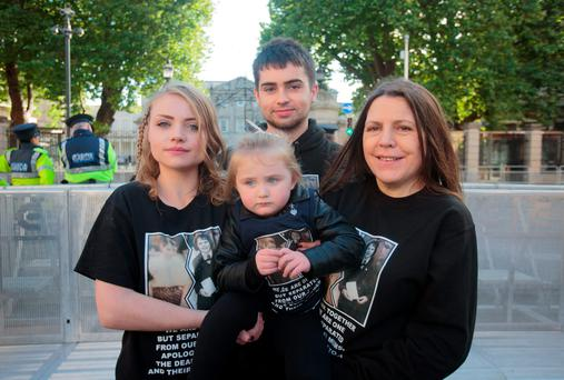 Members of the Collins Family & relatives of Angela Collins who spent 27 years in a Magdalene Laundry (L to R) Laura with her daughter Angel (3), Craig & there mother Mary all living in London protesting for the forgotten families of the victims of Institutional abuse in Magdalene laundries, Industrial Schools and Mother and Baby homes outside Leinster House, Dublin. Photo: Gareth Chaney Collins