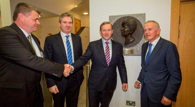 Taoiseach Enda Kenny is greeted on arrival at Independent House in Dublin by (from left) INM Chief Executive Robert Pitt, INM Editor-in-Chief Stephen Rea, and INM Chairman Leslie Buckley at the official opening of the INM newsroom. Photo: Mark Condren