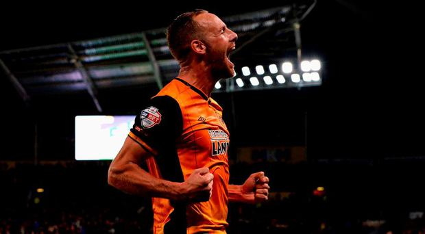 David Meyler of Hull City celebrates scoring the oprning goal during the Capital One Cup third round match between Hull City and Swansea City at the KC Stadium