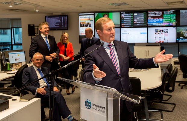 Taoiseach Enda Kenny speaks at the opening of the INM newsroom watched by INM chairman Leslie Buckley (seated) and INM Editor-in-Chief Stephen Rae (standing left)