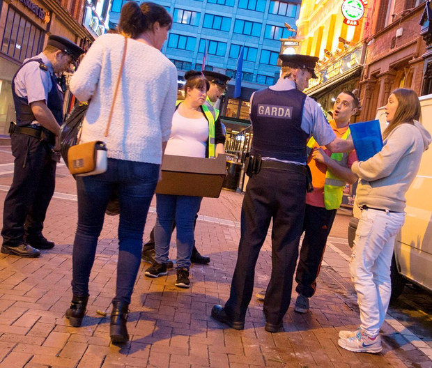Gardai and March for the Homeless volunteers discuss the issue on Harry Street, just off Grafton Street