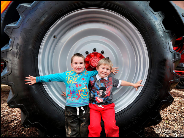 Cousins Lee Condron (3) and John Hennessy Jnr (4) both from Crettard, Co Laois, sit at the wheels of a spreader at the National Ploughing Championships Photo: Steve Humphreys
