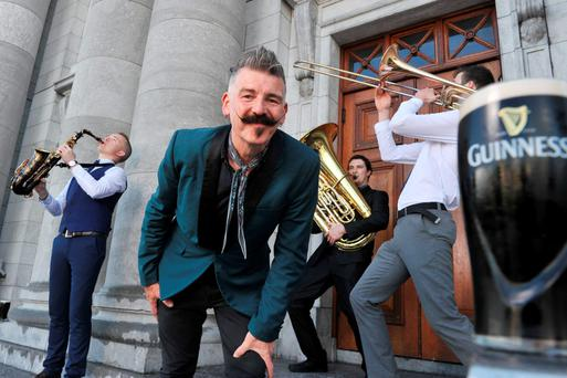 At the launch of the Guinness Jazz Festival were Jerry Fish and members of the CIT Cork School of Music Jazz Big Band - Liam O'Brien (saxophone), John O'Flynn (trombone) and Adrian Hanly (tuba). Photo: Daragh Mc Sweeney/Provision