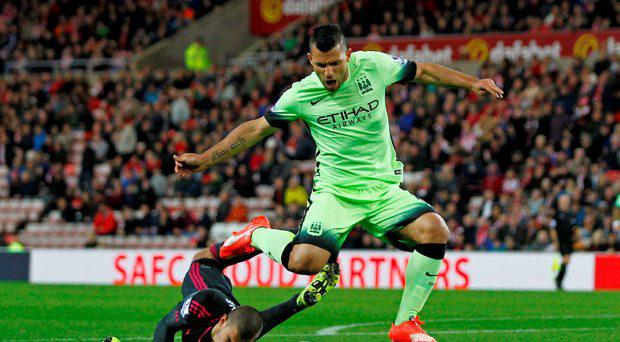 Manchester City's Sergio Aguero in action with Sunderland's Vito Mannone