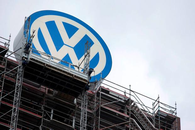 The Volkswagen logo sits atop the company's headquarters in Wolfsburg September 22, 2015