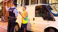 Gardai get Darren Bradley of The March for The Homeless to move his van from the street at Grafton St last night.