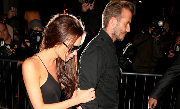David Beckham and Victoria Beckham at the Victoria Beckham store on Dover Street on September 22, 2015 in London, England. (Photo by Mark Robert Milan/GC Images)