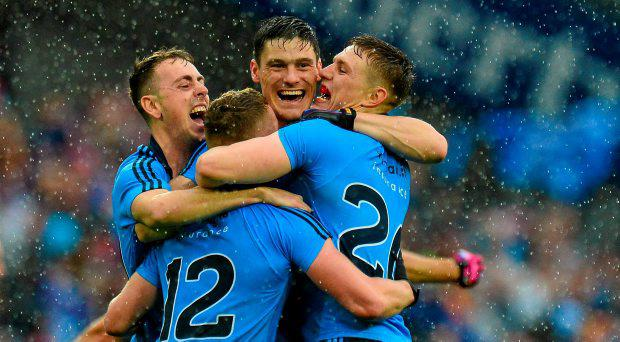 Dublin players, from left, Cormac Costello Ciaran Kilkenny, Diarmuid Connolly and Davy Byrne celebrate after the game