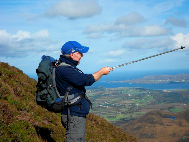 Walking guide Sean Mullan, pointing from Muckish in Ards Forest, Donegal.