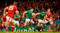 Jonathan Sexton, Ireland, breaks through the Canada defence on his way to scoring his side's third try. 2015 Rugby World Cup, Pool D, Ireland v Canada. Millennium Stadium, Cardiff, Wales. Picture credit: Brendan Moran / SPORTSFILE
