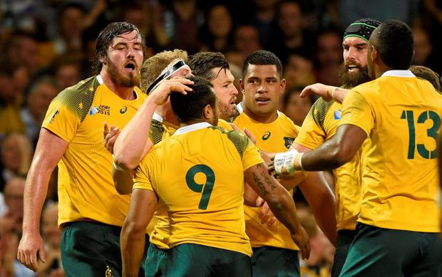 David Pocock celebrates with team mates after scoring the first try for Australia Reuters / Rebecca Naden
