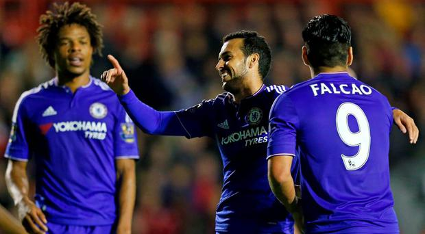 Pedro celebrates with team mates after scoring the fourth goal for Chelsea Reuters / Eddie Keogh