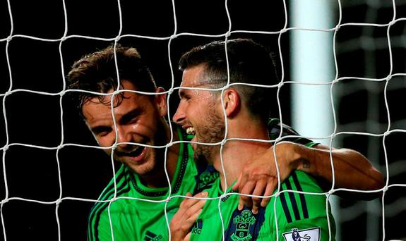 Southampton's Shane Long (right) celebrates scoring his team's fifth goal of the game with teammate Jay Rodriguez during the Capital One Cup, third round match at Stadium:MK, Milton Keynes.