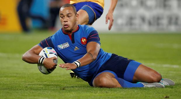 France's centre Gael Fickou scores his team's fifth try (Adrian Dennis/AFP/Getty Images)