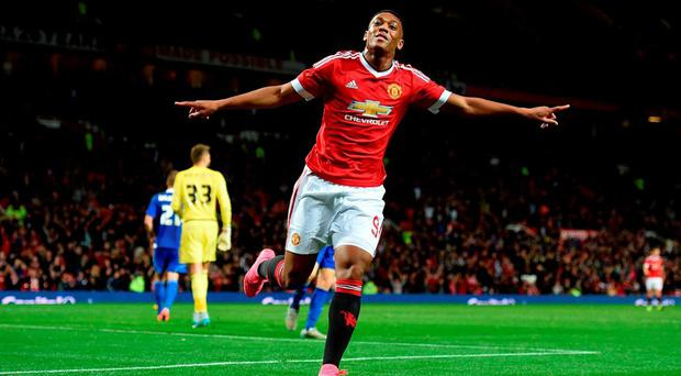 Manchester United's Anthony Martial celebrates scoring his team's third goal of the game during the Capital One Cup, third round match at Old Trafford