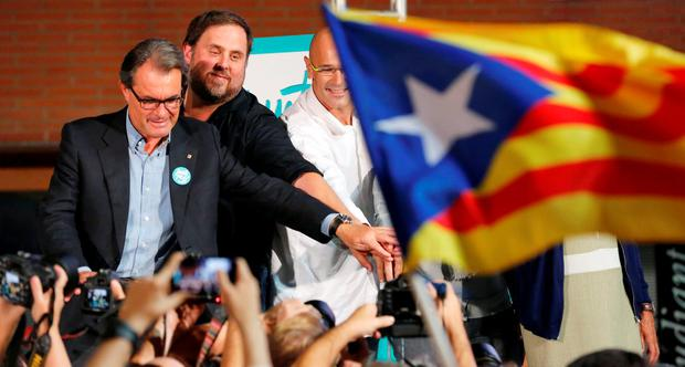 Catalonian leader Artur Mas (left) at a rally presenting the candidates of the Catalan pro-independence parties and civil societies