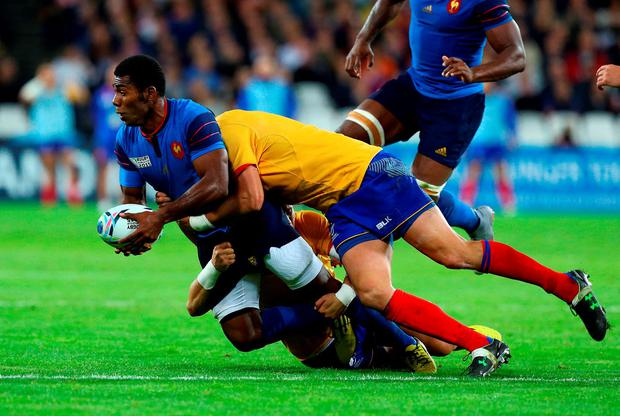 France's Noa Nakaitaci is brought down during the Rugby World Cup match at The Olympic Stadium, London. PRESS ASSOCIATION Photo. Picture date: Wednesday September 23, 2015. See PA story RUGBYU France. Photo credit should read: Gareth Fuller/PA Wire. RESTRICTIONS: Editorial use only. Strictly no commercial use or association without RWCL permission. Still image use only. Use implies acceptance of Section 6 of RWC 2015 T&Cs at:http://bit.ly/1MPElTL Call +44 (0)1158 447447 for further info.
