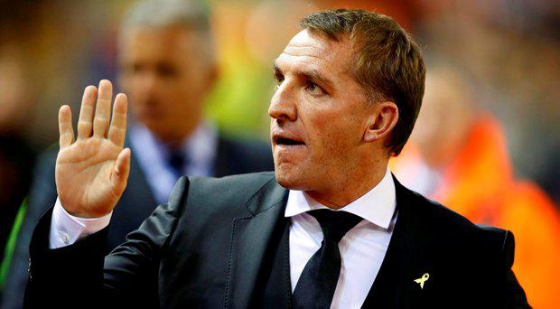 Liverpool manager Brendan Rodgers acknowledges the fans during the Capital One Cup, third round match at Anfield, Liverpool