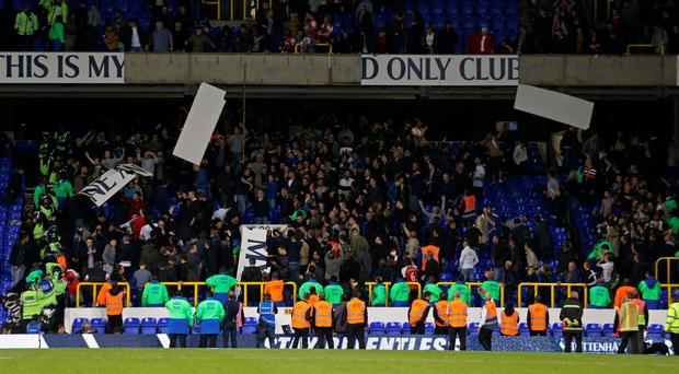 Arsenal fans rip boards off stadium at the end of the match