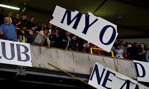 Arsenal fans rip boards at the end of the match Reuters / Toby Melville Livepic