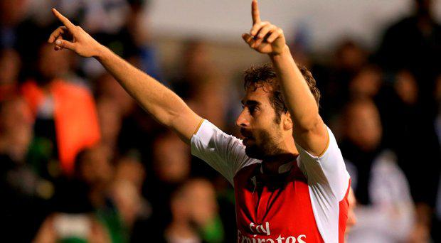 Arsenal's Mathieu Flamini celebrates scoring his side's second goal of the game during the Capital One Cup, third round match at White Hart Lane, London