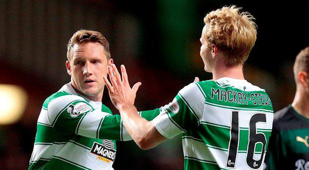 Celtic's Kris Commons celebrates scoring their first goal with Gary Mackay Steven