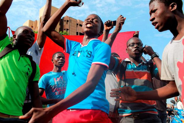 Anti-coup protesters sing the Burkinabe national anthem in Ouagadougou, Burkina Faso Credit: Joe Penney