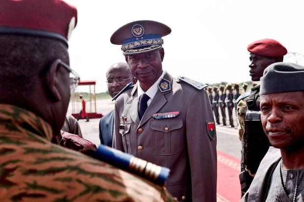 Burkina Faso coup leader Gen. Gilbert Diendere greets people at the airport during the arrival of Niger's President Mahamadou Issoufou for talks in Ouagadougou Credit: AP Photo
