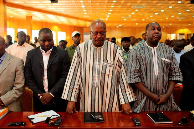 Burkina Faso political party leaders Roch Marc Christian Kabore (C) and Zephyrin Diabre (R) attend a ceremony marking the return of the transitional government in Ouagadougou, Burkina Faso Credit: Joe Penney