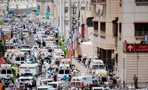 Saudi ambulances arrive with pilgrims who were injured in a stampede at an emergency hospital in Mina, near the holy city of Mecca Credit: MOHAMMED AL-SHAIKH
