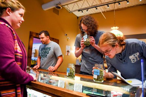 Suzy Presson helps Kevin Sager, Matt Branz, and Zach Griffin shop for marijuana at the Organic Alternatives store in Fort Collins, Colorado where cannabis is legal. Photo: Erin Hull