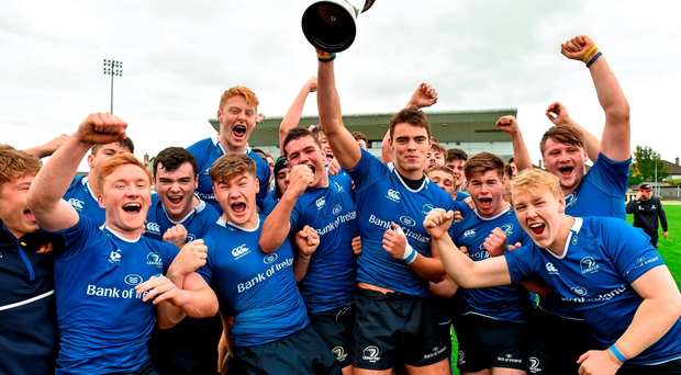 Leinster captain Conor Nash lifts the cup as his team-mates celebrate their 33-10 Interprovincial win over Connacht