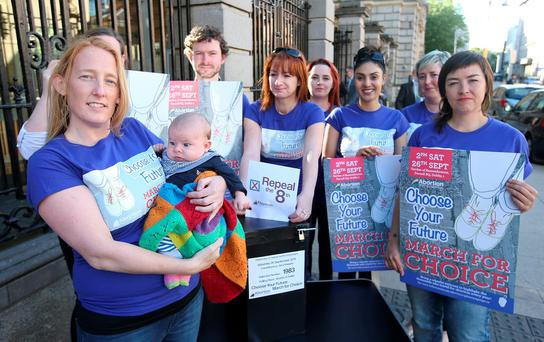 Claire Butler, holding her son, Naoise Butler MacCuirc, 2 months, joins Members of the Abortion Rights Campaign including Clare Daly, TD, centre outside Leinster House to highlight the March for Choice, taking place on Saturday 27th September. (Picture: Damien Eagers)