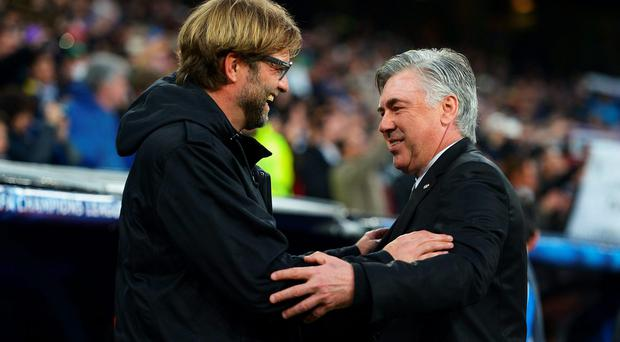 Juergen Klopp and Carlo Ancelotti after a Champions League match between Borussia Dortmund and Real Madrid last year. One of them could soon be trying to plot Liverpool's return to the competition