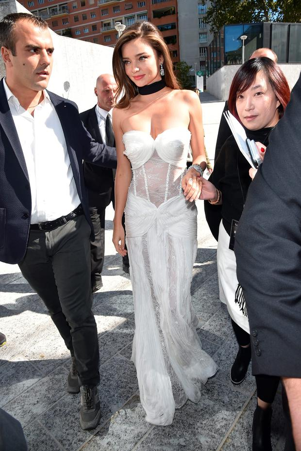 Miranda Kerr steals the show in white sheer dress at Milan ...
