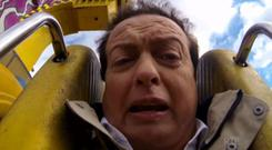 A terrified Marty Morrissey on the amusement ride at the Ploughing Championships.