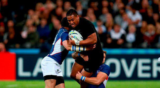New Zealand's Julian Savea (centre) attempts to break through the Namibia defense during the Rugby World Cup match at the Olympic Stadium, London