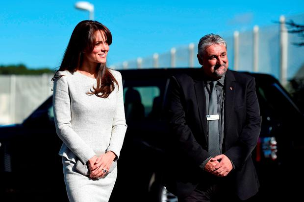 The Duchess of Cambridge is greeted by Governor of HMP Send Dave Charity (right) as she arrives at the prison in Surrey for a visit to the Rehabilitation of Addicted Prisoners Trust. Picture: Andrew Matthews/PA Wire