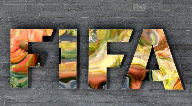 The FIFA logo is fixed on a wall of the FIFA headquarters during a meeting of the FIFA Executive Committee in Zurich, Switzerland