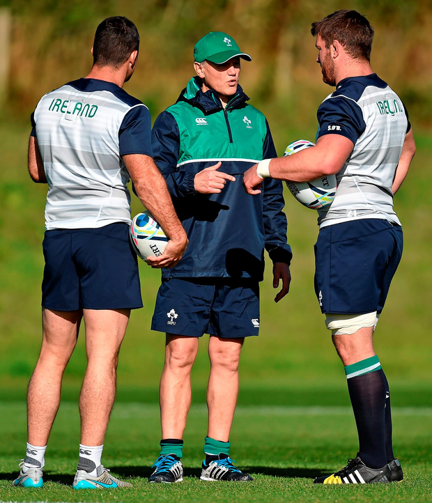 Ireland coach Joe Schmidt talks tactics with Rob Kearney and Sean O'Brien during the squad training session at St George's Park, Burton-upon-Trent yesterday ahead of tomorrow's World Cup clash with Romania at Wembley