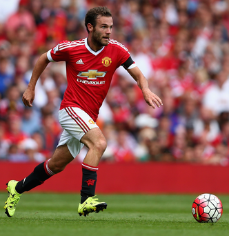 Into his stride: Juan Mata is flourishing under the guidance of Manchester United boss Louis van Gaal